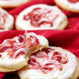 These meltaway cookies topped with cream cheese frosting and swirled with strawberry jam, simply melts in your mouth.