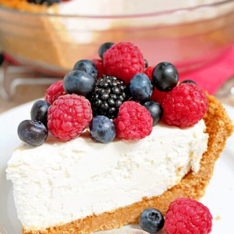 There is a crust made of graham crackers, sugar and cinnamon, then cheesecake filling made of cream cheese, heavy cream, sugar and lemon juice and fresh berries mix on the top ♥