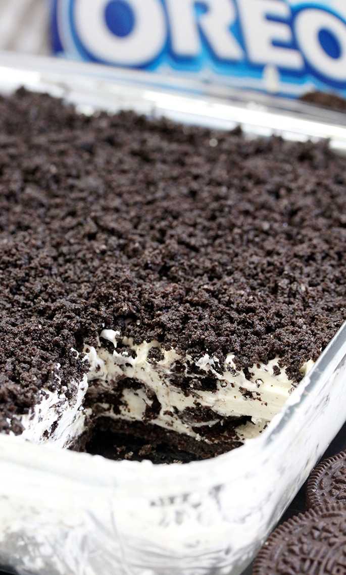 The first layer is made of Oreo cookies and butter, than comes frozen layer of cream cheese, sugar, heavy cream, condensed milk, vanilla and crushed Oreo cookies with Oreo crumbs on the top.