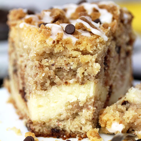 This Cheesecake Banana Bread Crumb Cake is a rich banana cake filled with cheesecake and crumb topping on the top. Start your day with this dessert and a cup of coffee or tea 🙂