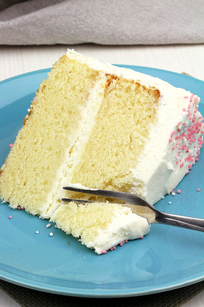 This Vanilla Cake with Whipped Cream Cheese Frosting is perfectly moist, easy and airy vanilla cake with filling made of vanilla cream cheese and heavy whipping cream.