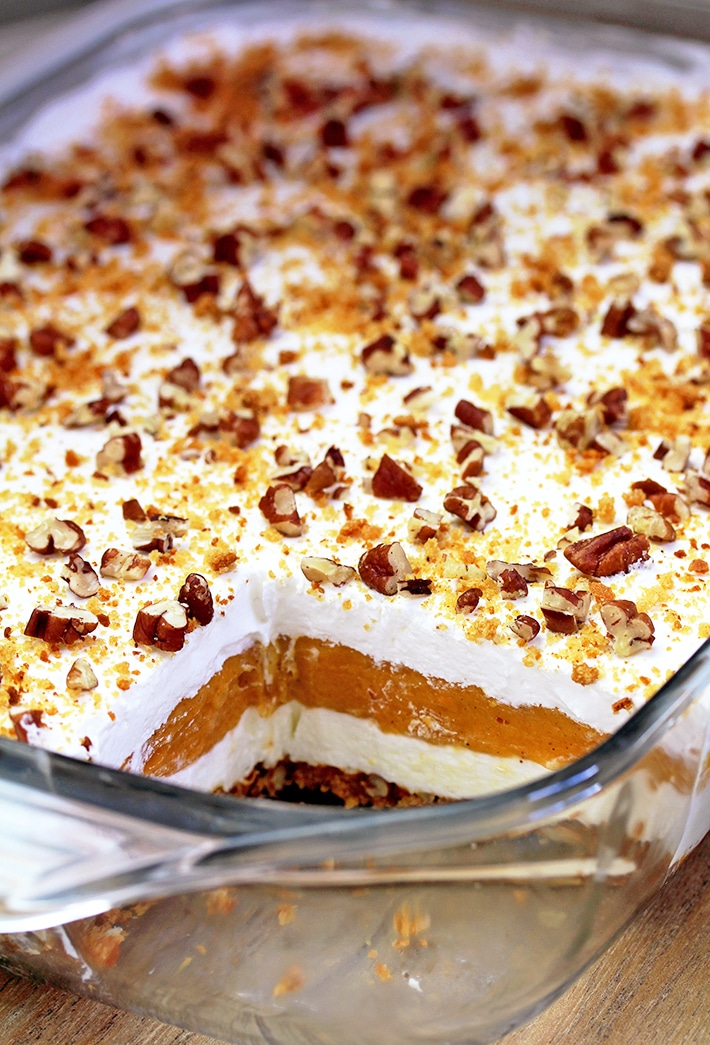 Pumpkin Lush – this fast-made, light, yet delicious creamy dessert, with cheese cream and pumpkin layers, and gingersnap cookie crust, topped with chopped pecans and gingersnap cookie crumbs, will delight all the pumpkin lovers.
