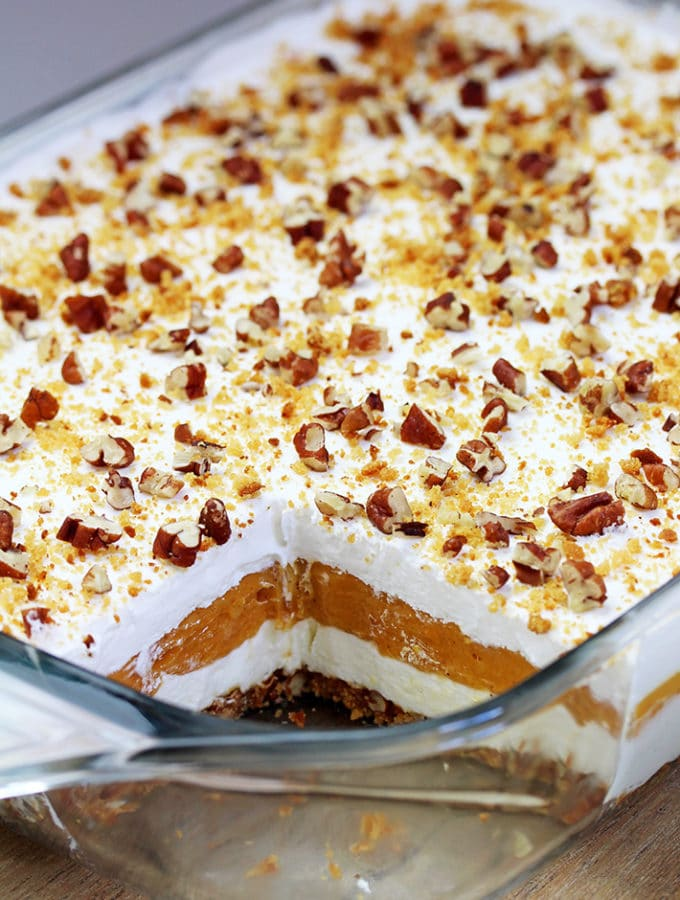 Pumpkin Lush – this fast-made, light, yet delicious creamy dessert, with cheese cream and pumpkin layers, and gingersnap cookie crust, topped with chopped pecans and gingersnap cookie crumbs, will delight all the pumpkin lovers