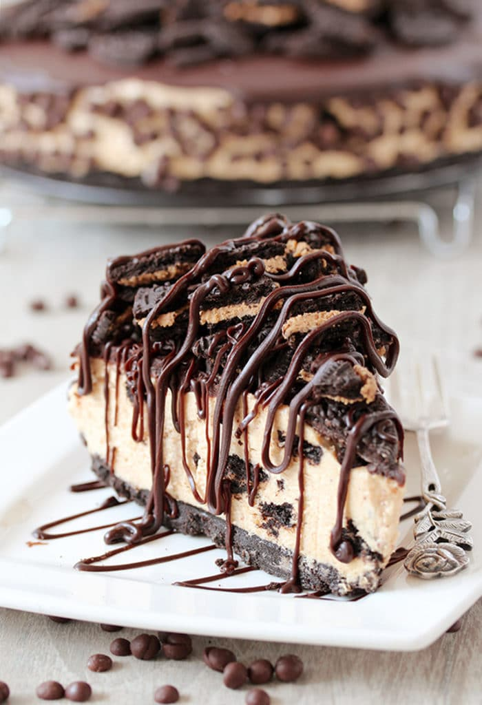 This No Bake Peanut Butter Oreo Cheesecake is a delicious dessert with peanut butter Oreo layer and peanut butter cheesecake filling, topped with chocolate ganache and crushed Oreos.