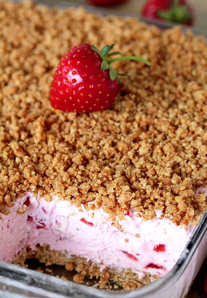 This refreshing, creamy, frozen dessert made with fresh strawberries and a crunchy graham cracker layer, topped with graham cracker crumbs is very quick and easy to prepare.