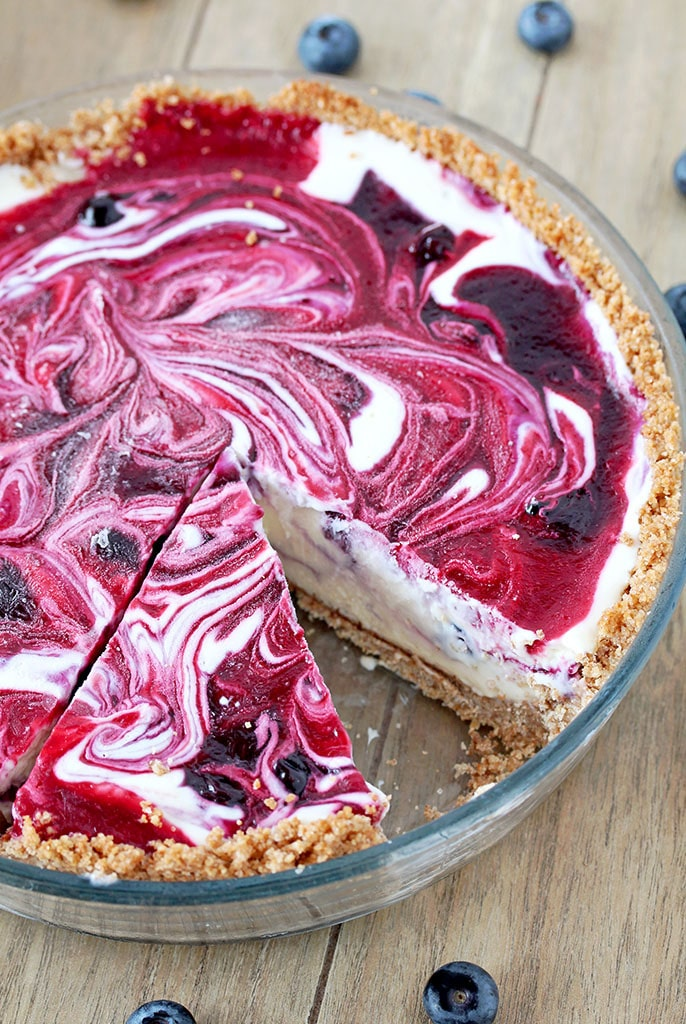 Very Berry Frozen Cream Pie is a dessert with fresh season blueberries and raspberries, just perfect refreshment for hot summer days. If you like ice cream, especially fruit, you will love this pie. This is one of my favorite summer desserts. Graham cracker pie crust, frozen cream, swirls with homemade blueberry and raspberry filling… Pure perfection, if you ask me
