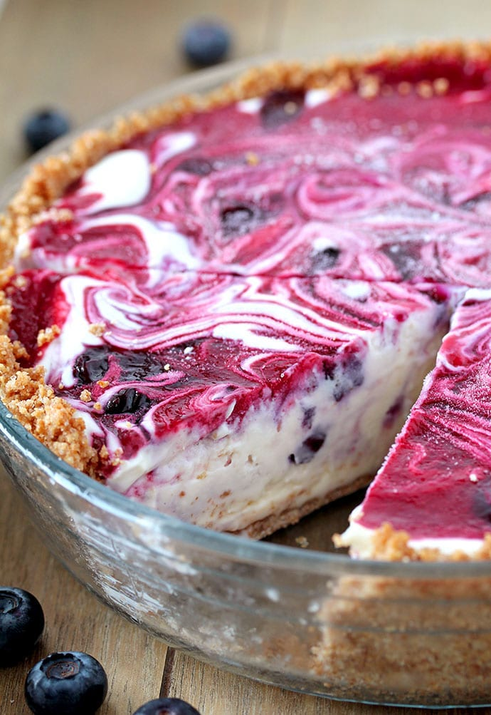 Very Berry Frozen Cream Pie is a dessert with fresh season blueberries and raspberries, just perfect refreshment for hot summer days. If you like ice cream, especially fruit, you will love this pie. This is one of my favorite summer desserts. Graham cracker pie crust, frozen cream, swirls with homemade blueberry and raspberry filling... Pure perfection, if you ask me.