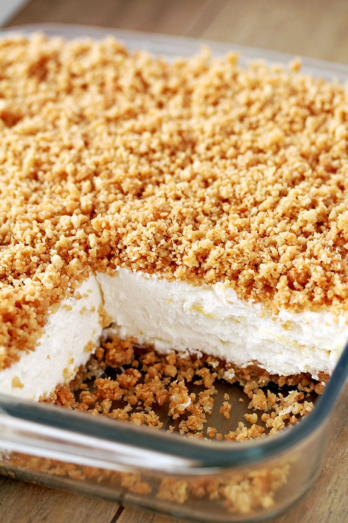 Easy Pineapple Dream Dessert a light and fluffy, quick and easy no bake creamy summer dessert. This creamy treat, made of crushed pineapple, cream cheese, butter and whipped cream and crunchy graham cracker layer, topped with graham cracker crumbs is a perfect way to sweeten hot summer days
