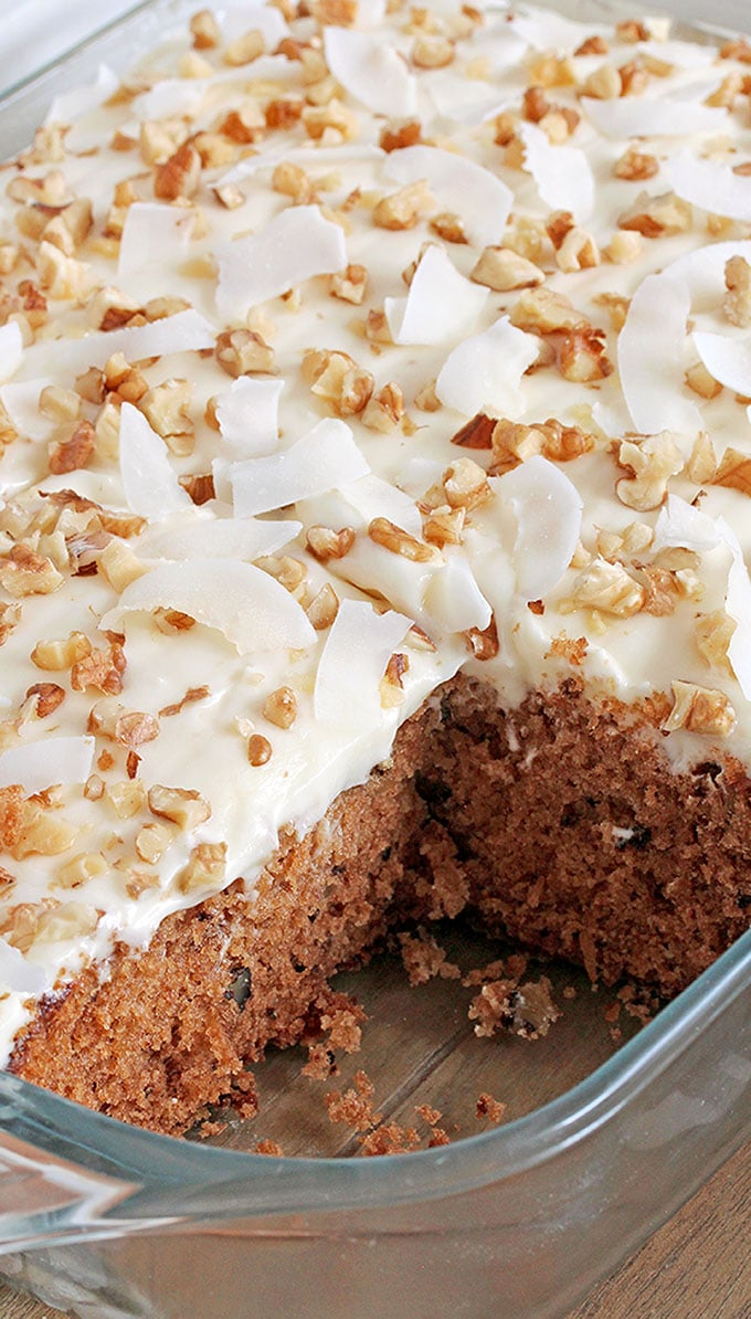 Preacher Cake – easy, super tasty cake with rich, tropical taste topped with whipped cream cheese frosting, chopped walnuts and coconut chips. This harmony of flavors is made for true pleasure. Pineapple, coconut and walnut combination in this cake is perfect and gives it a special taste.