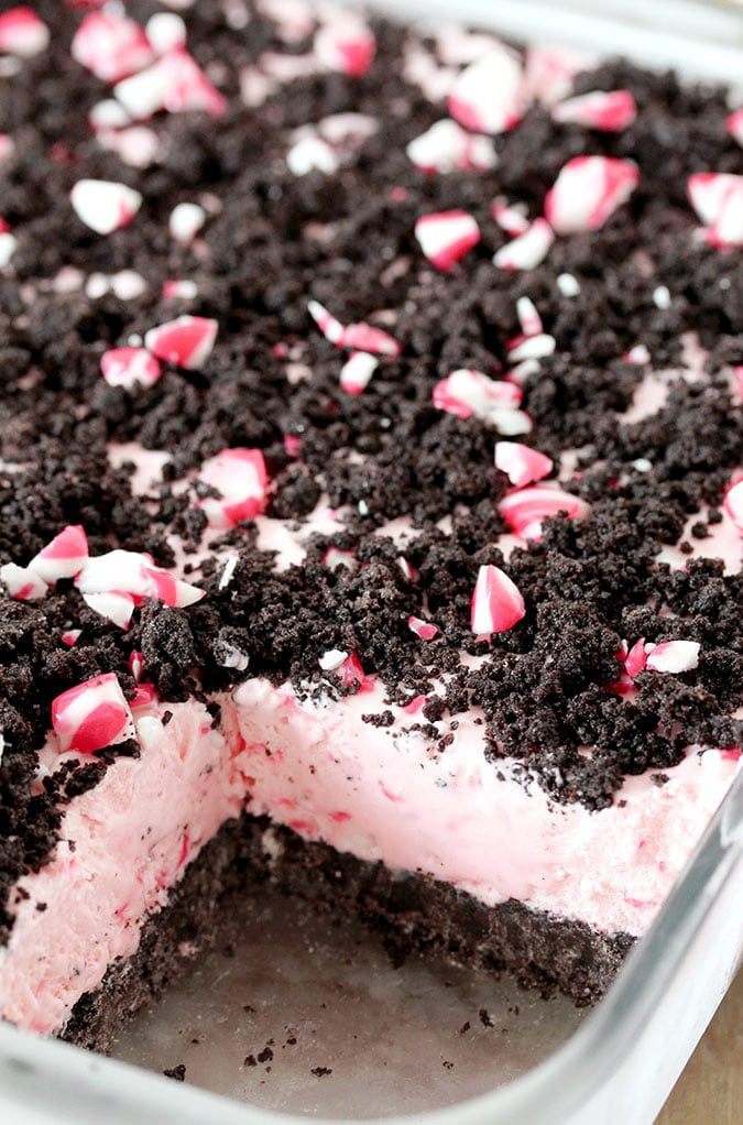 Easy Frozen Peppermint Dessert – this quick and easy holiday treat is made of peppermint candies, cream cheese, whipped cream and sweetened condensed milk, it has an Oreo layer and is topped with crushed peppermint candies and Oreos.