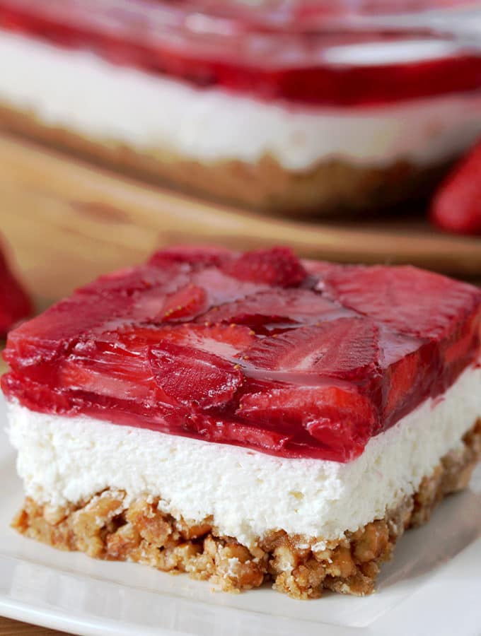 Strawberry Jello Pretzel Salad is a very tasty, old fashioned dessert that is so easy to prepare and that everyone loves. It consists of three different layers. The first one is made of crushed pretzels, sugar and melted butter and it´s baked for 10 minutes. Then, the second layer made of cream cheese, sugar and cool whip comes. For the third layer you will need strawberries, strawberry jello and water