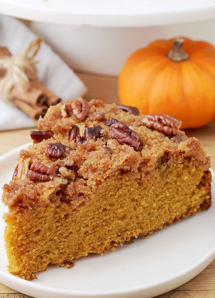 This Easy Pecan Pumpkin Coffee Cake is just perfect for breakfast or brunch with a cup of coffee, in fall. It is soft and moist, made of pumpkin and topped with crunchy brown sugar, cinnamon and pecan topping – so simple and yet incredibly delicious.