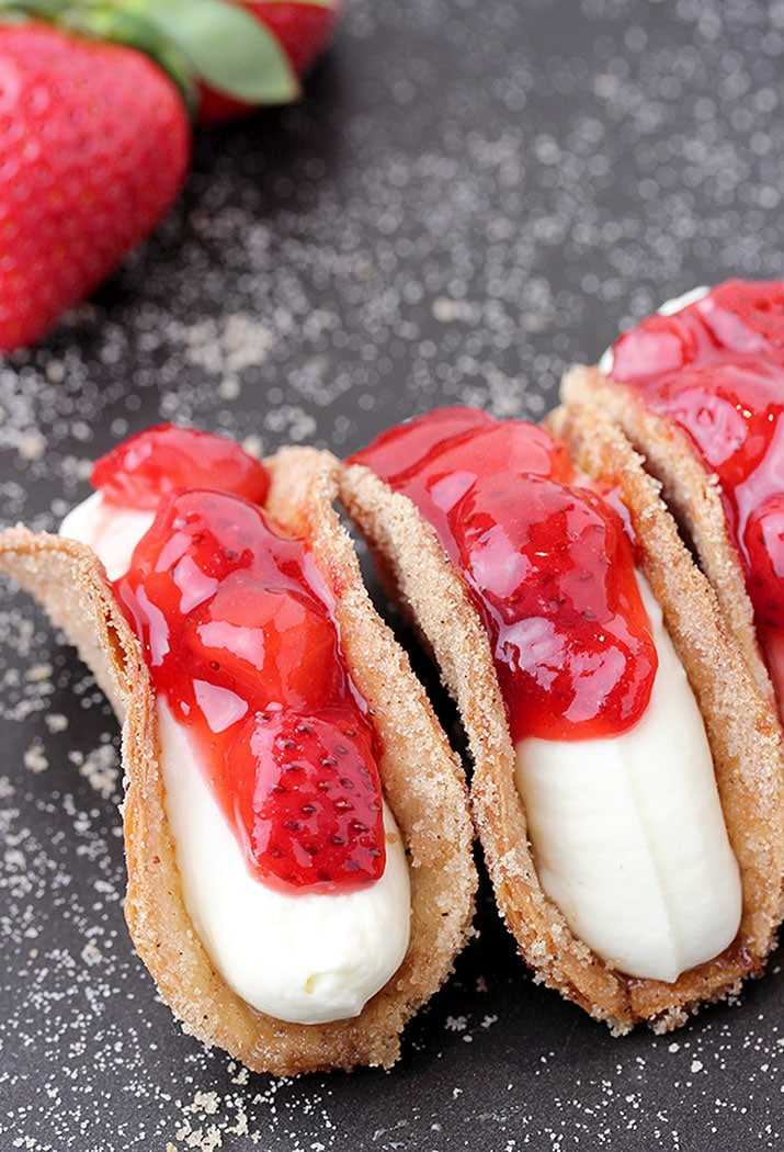 Strawberry Cheesecake Tacos – crunchy cinnamon and sugar tortilla shells, filled with cheesecake and topped with homemade strawberry sauce are perfect bites for every occasion. They are so easy to make, they look great and taste even better.