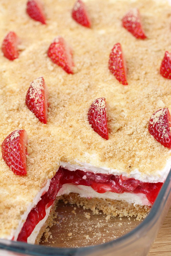 Strawberry Yum Yum – this quick and easy recipe, for no bake, layered dessert will surely become one of your favorites. What makes this cake truly delicious is graham cracker layer, followed by cheesecake, and then strawberry layer, another cheesecake and all is topped with graham cracker crumbs.