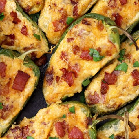 Jalapeno Poppers – homemade, oven baked jalapeno peppers cut in half and filled with the mixture of cream cheese, mozzarella and cheddar cheese, crunchy bacon and spices make a perfect party appetizer or a snack.
